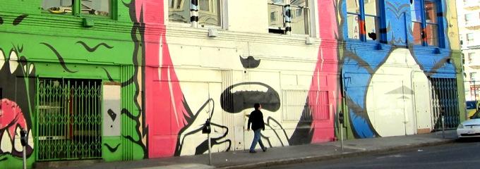 Three drawings on wall in Tenderloin San Francisco