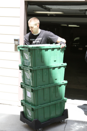 Mover moving plastic green boxes