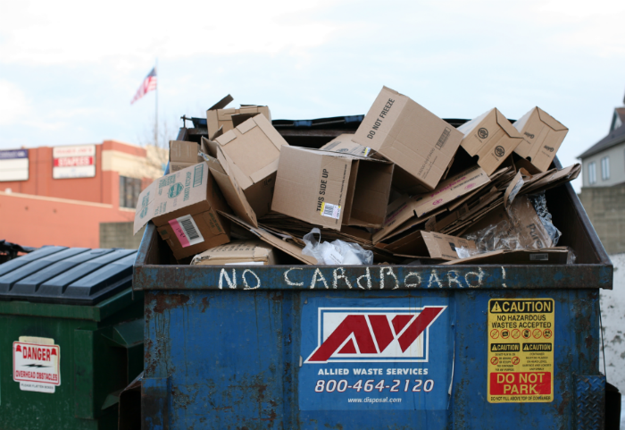 Cardboard Boxes In Dumpster