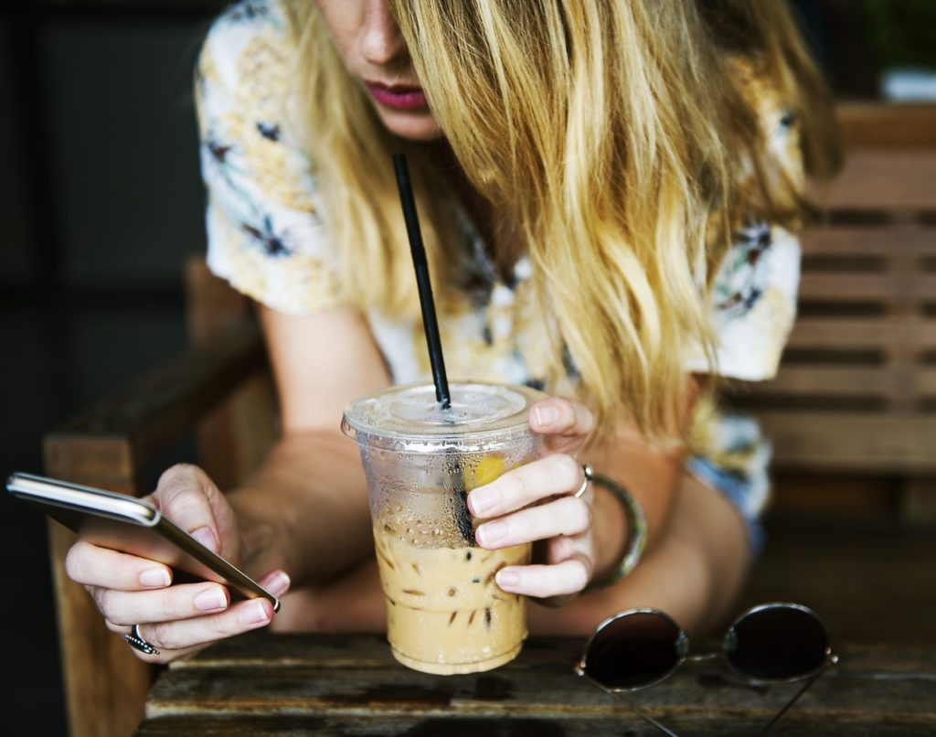 lady drinking coffee on phone